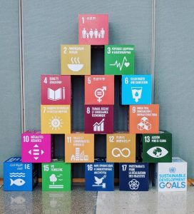 Brightly colored blocks are stacked with the UN's NGO Conference agenda items written on them.