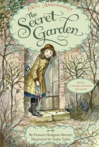 Cover art by Tasha Tudor for The Secret Garden shows an illustration of a little girl wearing a hat and rain jacket walking through a door with plants on either side.
