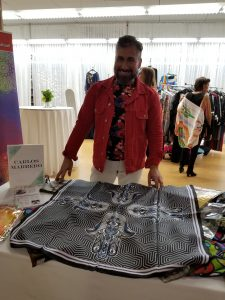 Artist displays his handmade scarf.