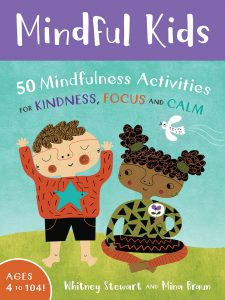 Cover of Mindful Kids shows a boy standing and a girl sitting.