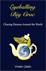 Cover of Eyeballing Big Croc shows a crocodile coming out of a teapot with the world centered on the teapot.