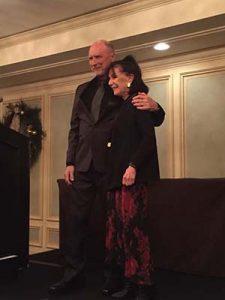 Photo of Patty Friedmann receiving her award.