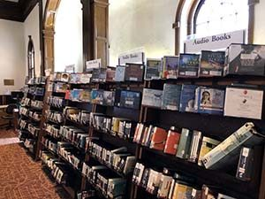 Photo of the audiobooks section of a public library.