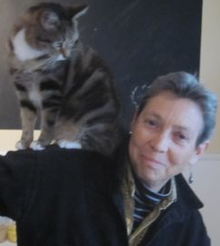 NC Weil's cat, Bonnie, is perched on her shoulder.