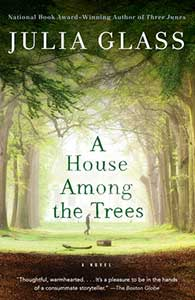 A House Among the Trees' cover has a path that is surrounded by green trees and a person in profile in the mid-distance is walking.