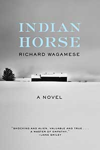 Book cover for Indian Horse shows a dark, gray sky with a white snow foreground and a house with a conifer tree nearby.