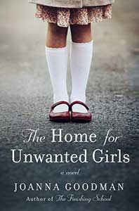 The Home for Unwanted Girls book cover shows the lower legs of a girl with the hem of a skirt or dress showing who is wearing white, knee-high socks and patent leather Mary Jane's standing on pavement.