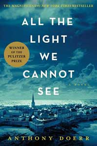 The book cover for All the Light We Cannot See has a blue sky with some white clouds over a body of water with a town in the foreground.