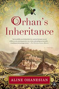 The book cover for Orhan's Inheritance shows a village next to a mountain.