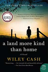 The book cover for A Land More Kind Than Home has a pastoral scene with a child standing by a wire fence looking at a sunset.