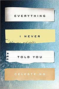 The book cover for Everything I Never Told You has a blue background and strips of torn paper behind each word in the title.