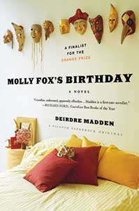The book cover for Molly Fox's Birthday shows a bed with a variety of masks hanging on the wall above it.