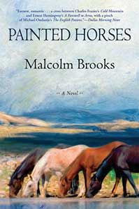 Four horses of varying colors are drinking water from a river on the book cover of Painted Horses.