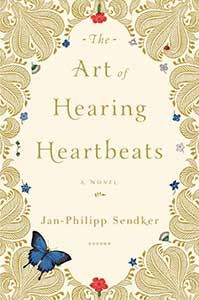 The book cover for the Art of Hearing Heartbeats is ornate. There is a scrollwork design with a diamond-like cutout in the center where the title is. There are butterflies, stars, and flowers on the cover too.