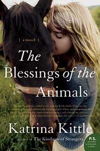 The book cover for the Blessings of the Animals shows a woman hugging a horse.