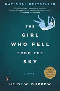 The book cover for The Girl Who Fell from the Sky shows a greenish blue cover with an outline of a girl falling. In the outline, is a blue sky with clouds.