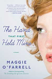 The book cover for the Hand That First Held Mine shows a partial profile of a woman's face.