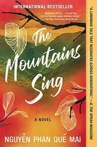 The book cover for The Mountains Sing has rich red, yellowish gold, and green coloring the sky and mountains. A tree with brown limbs and white drawn leaves are scattered over the whole cover.