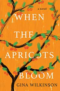 The book cover for When the Apricots Bloom is orange with a blooming apricot tree winding over it.